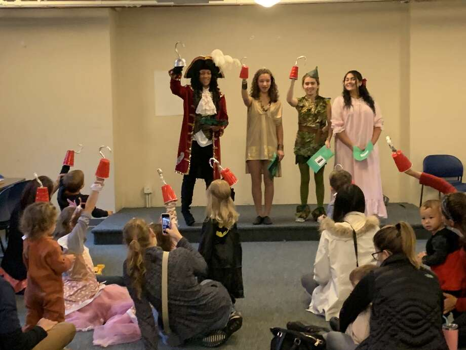 Students Laniyah Diaz as Captain Hook and Meg Harkins as Peter Pan visited the Hamden Library and St. Rita School to celebrate Halloween. Photo: MaryLee Delaney