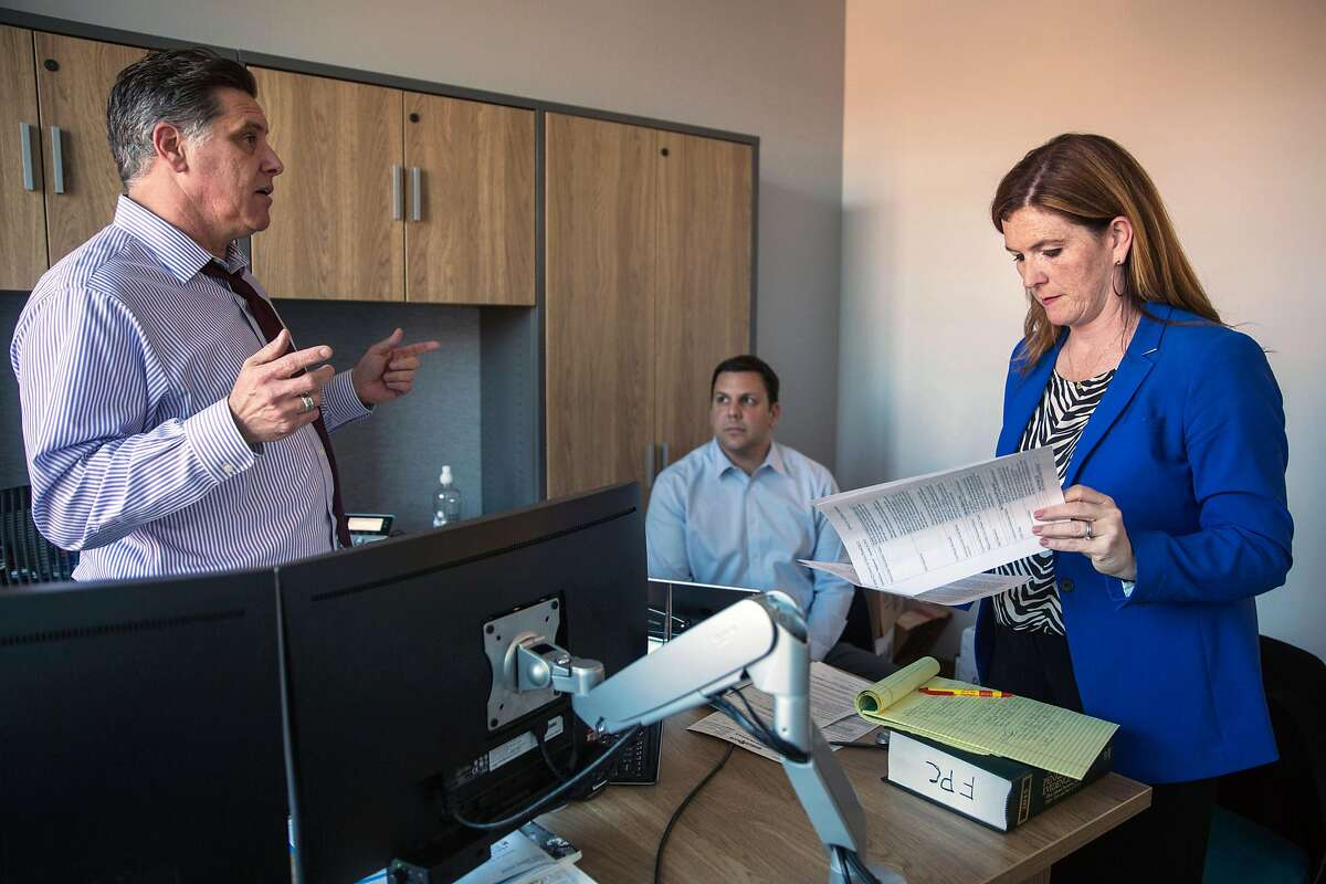 Suzy Loftus, interim District Attorney of San Francisco talks to Sean Connolly, Chief of Crime Strategy Unit and Neighborhood Prosecutors Program, left, and Myles Campbell, Assistant District Attorney, at the District Attorney's office on Potrero Hill. Wednesday, October 30, 2019. San Francisco, Calif.