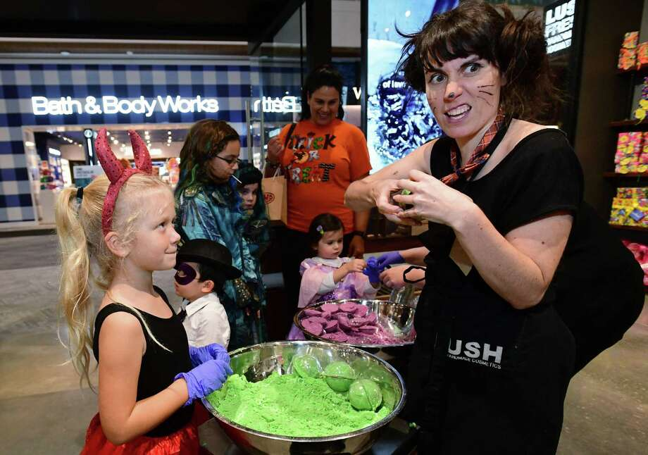 Penny White, 7 of Norwalk, makes a bath bomb with Lush Shop Manager Amy Merli as children trick-or-treat at The SoNo Collection during the new mall's Malloween event Thursday, October 31, 2019, in Norwalk, Conn. Retailers offered candy and crafts for costumed revelers. Photo: Erik Trautmann / Hearst Connecticut Media / Norwalk Hour