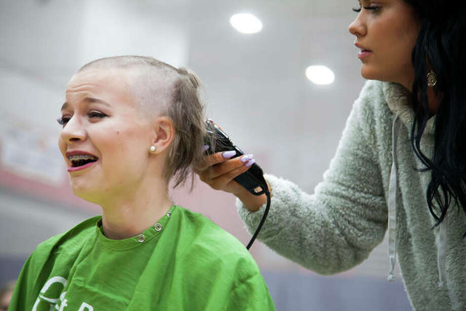 Natalie Boyles, reacts to getting her head shaved Thursday during Alton High School's St. Baldrick's event, a charitable fundraiser to help kids with cancer. The annual event has raised approximately $105,000 since it started 11 years ago. Photo: Photos By Jeanie Stephens | The Telegraph