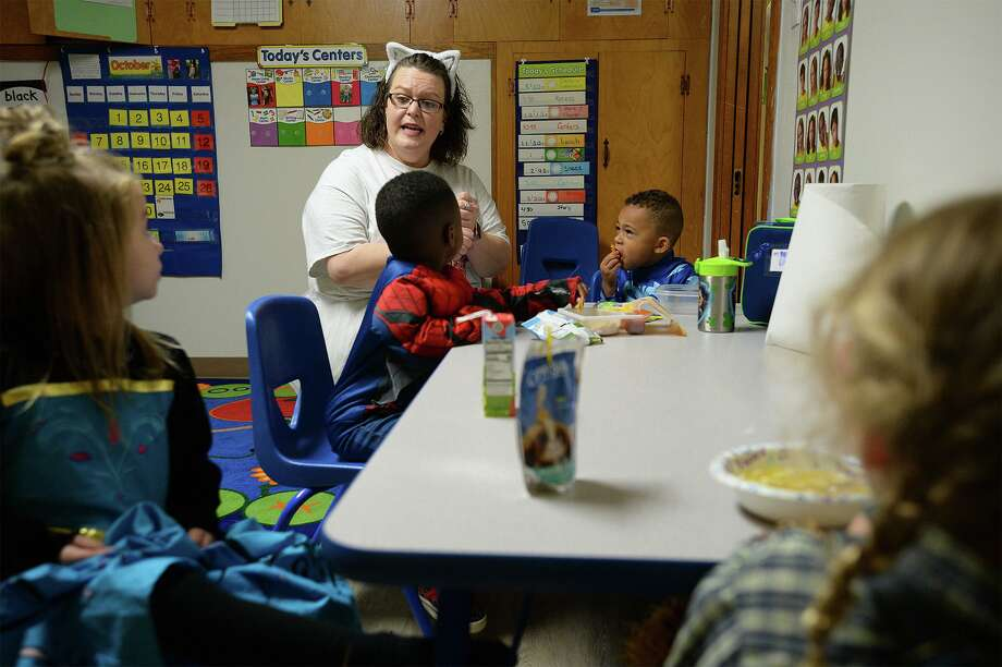 Kena Mahan teaches class at All God's Children Preschool in Kirbyville Thursday. The school is the first for pre-kindergarten students in the city. From left, Brittlynn Kroner, Zaxton Thomas, Major Diggles and Everlee Elliott are also pictured. Photo taken Thursday, 10/31/19 Photo: Guiseppe Barranco/The Enterprise, Photo Editor / Guiseppe Barranco ©