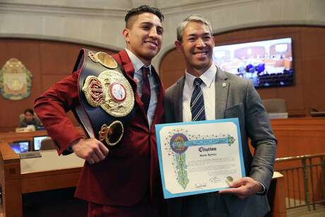 """World Boxing Association Super Lightweight Champion Mario Barrios, 24, left, poses with Mayor Ron Nirenberg after he is honored by the San Antonio City Council, Thursday, Oct. 31, 2019. Barrios, aka """"El Azteca"""" beat Batyr Akhmedov, of Uzbekistan, in September to claim the title. Barrios has a 25-0-0 and 16 knockouts."""