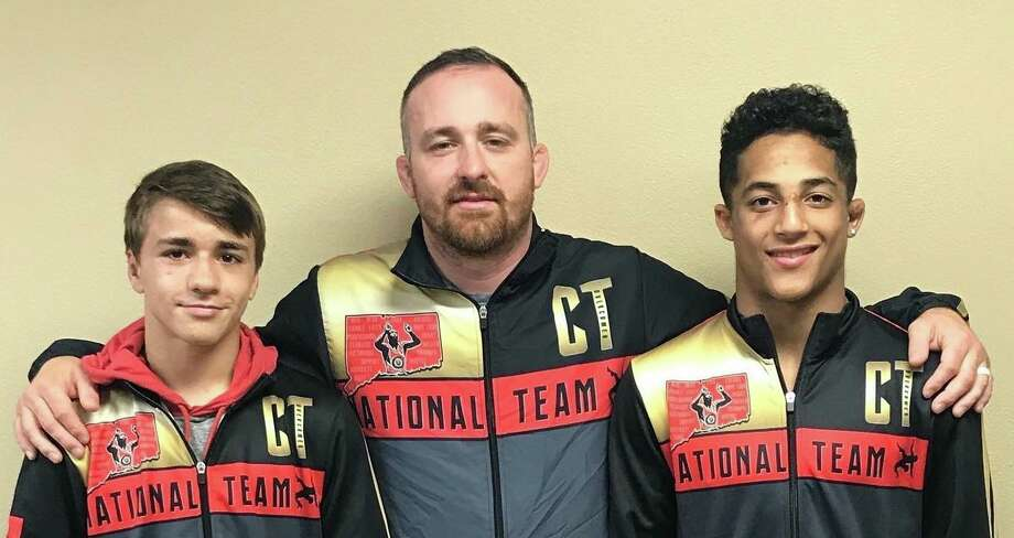 Michael Longo and Nico Provo flank Southside Wrestling Club coach Jack Conroy after each earned All America honors. Photo: Contributed Photo / South Side Wrestling / Trumbull Times