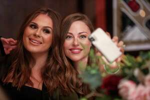 Meredith Flores, left, and Lexi Sakowitz take a selfie