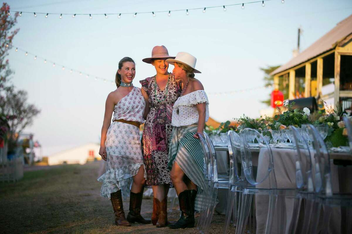 Hostesses Kelli Bunch, Marcia Smart and Courtney Paddock of the Farm Girls Supper Club pose before dinner at Marburger Farm on Wednesday, Oct. 2, 2019, in Round Top, TX.