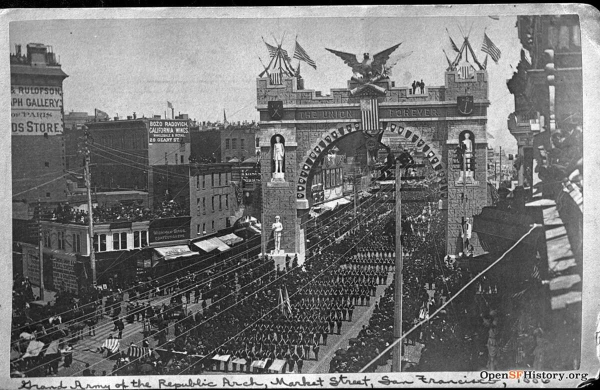 A parade goes through the Grand Army of the Republic Arch on Market Street in San Francisco, 1886.