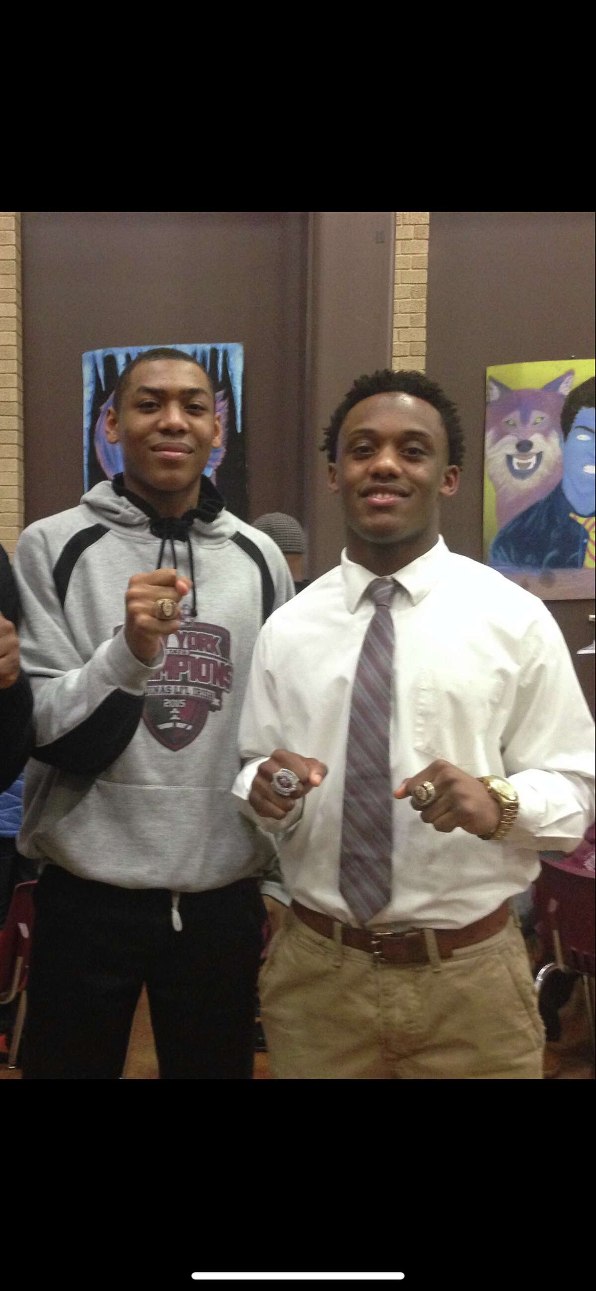 Jalen Pickett, left, and Earnest Edwards showed off their championship jewelry as teammates at Aquinas Institute in Rochester. (Courtesy of Jalen Pickett)