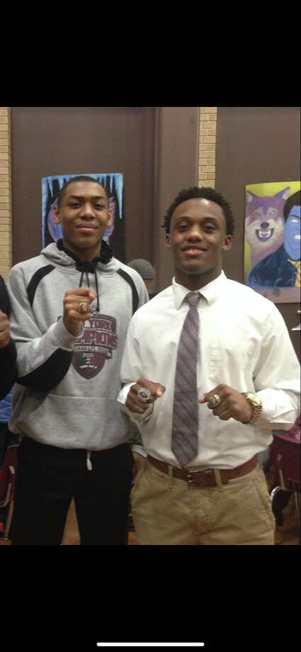 Jalen Pickett, left, and Earnest Edwards showed off their championship jewelry as teammates at Aquinas Institute in Rochester. (Courtesy of Jalen Pickett) Photo: Jalen Pickett