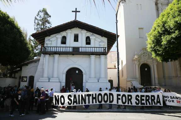 Demonstrators gather in front of Mission Dolores as they protest the canonization of Junipero Serra on Wednesday, September 23, 2015 in San Francisco, Calif.