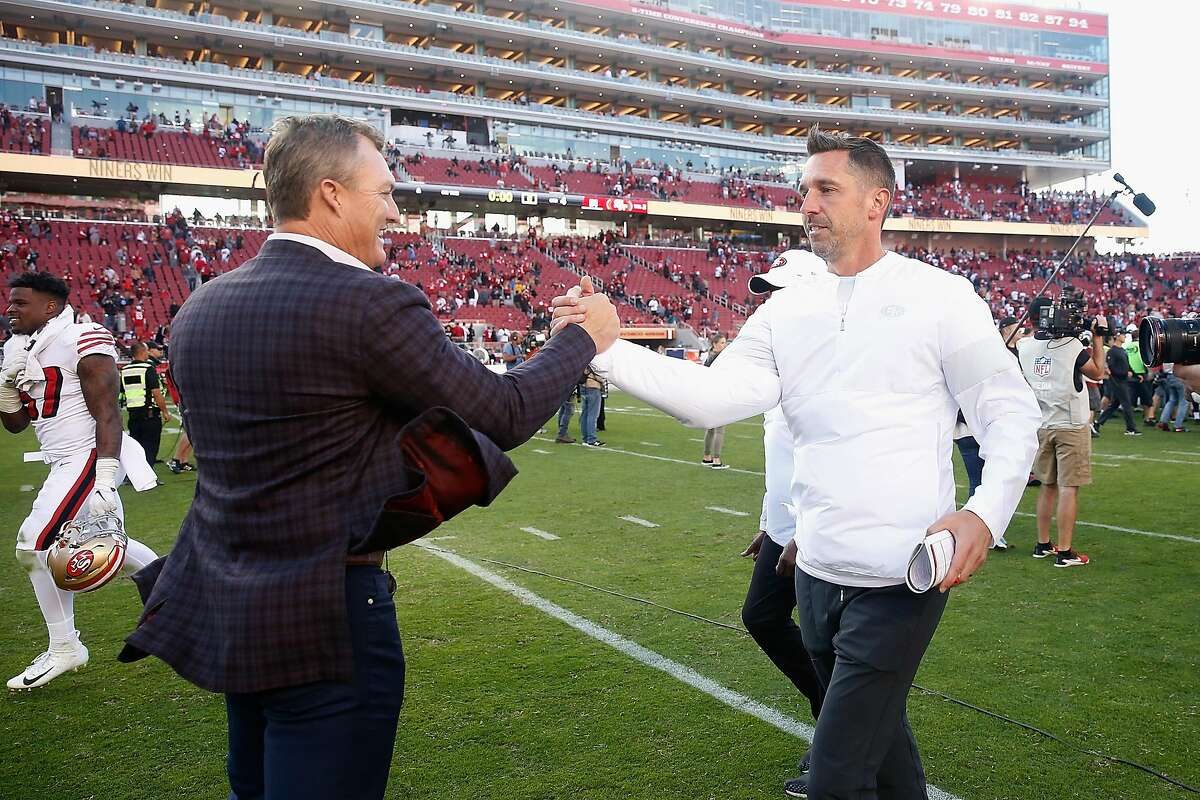 SANTA CLARA, CALIFORNIA - OCTOBER 27: San Francisco 49ers General Manager John Lynch congratulates head coach Kyle Shanahan after a win against the Carolina Panthers at Levi's Stadium on October 27, 2019 in Santa Clara, California. (Photo by Lachlan Cunningham/Getty Images)