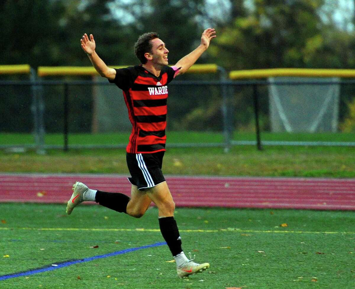 Fairfield Warde's Jake Berecz (21) celebrates after scoring a goal against Fairfield Ludlowe during boys soccer action in Fairfield, Conn., on Thursday Oct. 31, 2019.