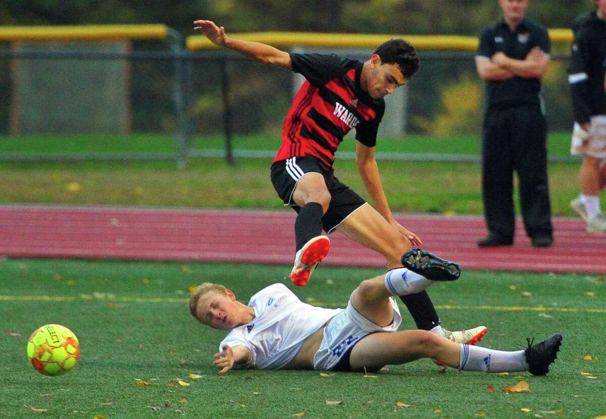 Fairfield Ludlowe's Timothe Marilhet (22) slides to block Fairfield Daniel Villalba (11) during boys soccer action in Fairfield, Conn., on Thursday Oct. 31, 2019.