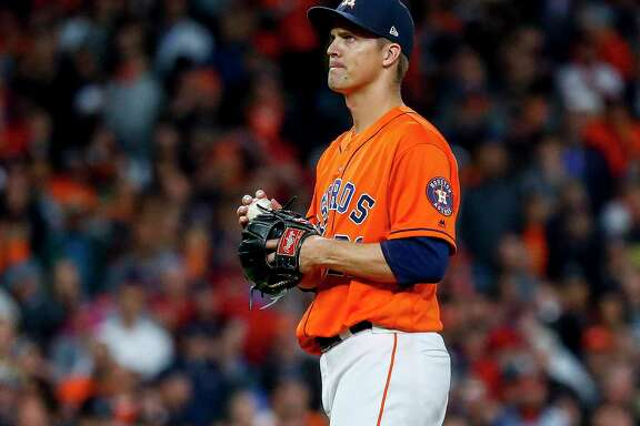 After walking the Nationals' Juan Soto with one out in the seventh inning of World Series Game 7, Astros pitcher Zack Greinke awaits manager A.J. Hinch, who would remove him with a 2-1 lead and his pitch count at 80.