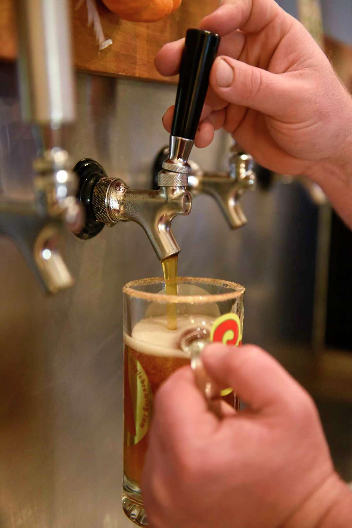 Sean Murphy pours a pumpkin ale at the Argyle Brewery Company on Thursday, Oct. 31, 2019 in Greenwich, N.Y. (Lori Van Buren/Times Union)