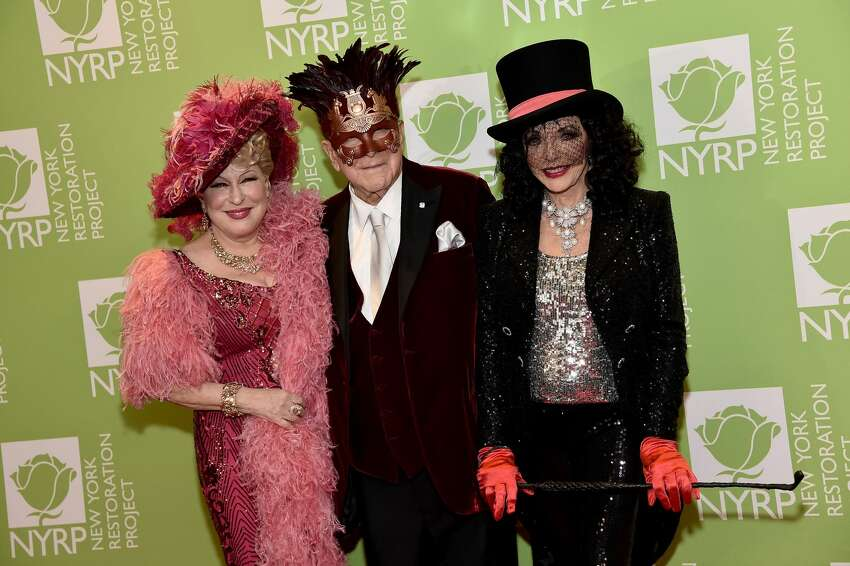 NEW YORK, NEW YORK - OCTOBER 31: Bette Midler, Clive Davis, and Joan Collins attend Bette Midler's 2019 Hulaween at New York Hilton Midtown on October 31, 2019 in New York City. (Photo by Steven Ferdman/Getty Images)