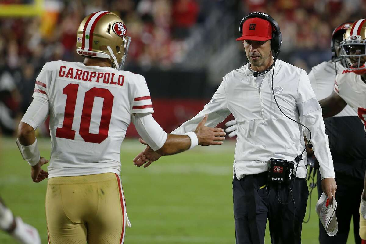 San Francisco 49ers quarterback Jimmy Garoppolo (10) greets San Francisco 49ers head coach Kyle Shanahan after a touchdown against the Arizona Cardinals during the first half of an NFL football game, Thursday, Oct. 31, 2019, in Glendale, Ariz. (AP Photo/Rick Scuteri)