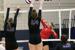 Staunton freshman Haris Legendre has her attack blocked by Breese Central's Abby Johnson (24) in a double block with teammate Riley Gebke early in the first set of the Greenville Class 2A Regional championship match on Thursday night.