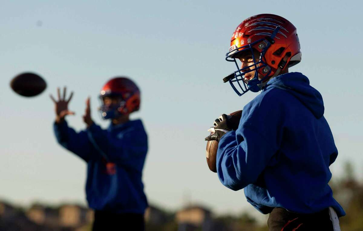 Grand Oaks football players warm up before a non-district high school football game at Woodforest Bank Stadium, Thursday, Oct. 31, 2019, in Shenandoah.