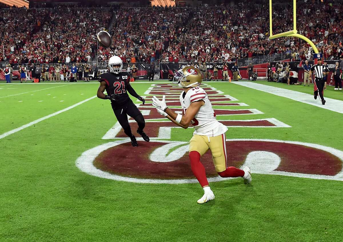Dante Pettis #18 the San Francisco 49ers catches a second half touchdown against of the Arizona Cardinals at State Farm Stadium on October 31, 2019 in Glendale, Arizona. Because of a coronavirus surge in numerous California counties, including Santa Clara County where the Niners call home, county health officials have banned any contact sports for three weeks, meaning the 49ers and other pro and college sports teams must find new places to practice and play their home games. The 49ers may set up a 'bubble' environment, calling the Cardinals' stadium home for the rest of the season.