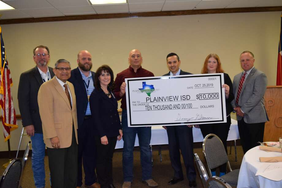 Plainview ISD accepted a $10,000 check from the Plainview/Hale County Economic Development Corporation during the EDC's quarterly board meeting on Tuesday. Photo: Ellysa Harris/Plainview Herald