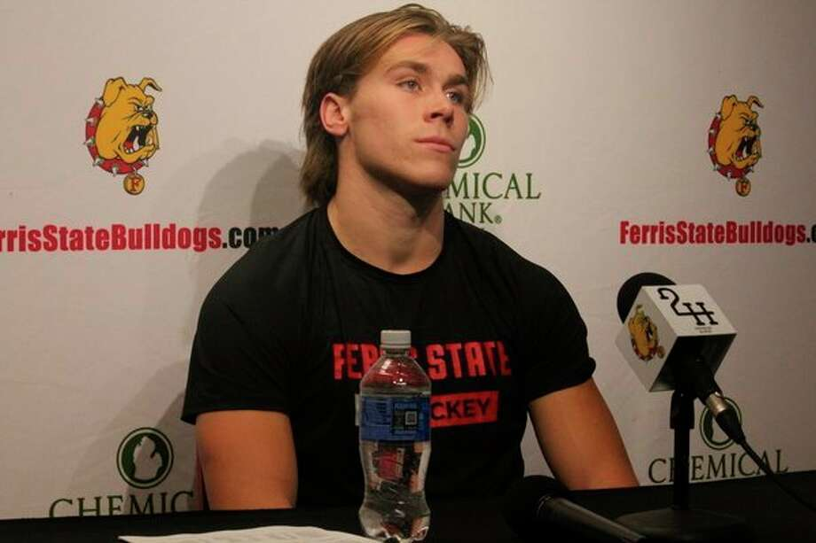 Ferris' Marshall Moise speaks to the media after Saturday's game. (Pioneer photo/John Raffel)