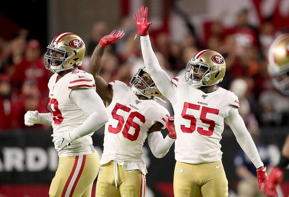 Defensive end Dee Ford #55 , middle linebacker Kwon Alexander #56 and defensive tackle DeForest Buckner #99 of the San Francisco 49ers celebrate a sack during the game against the Arizona Cardinals at State Farm Stadium. Photo: Christian Petersen / Getty Images