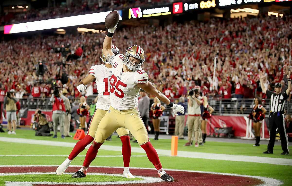 Tight end George Kittle #85 of the San Francisco 49ers celebrates his touchdown in the first quarter over the Arizona Cardinals at State Farm Stadium on October 31, 2019 in Glendale, Arizona. ~~