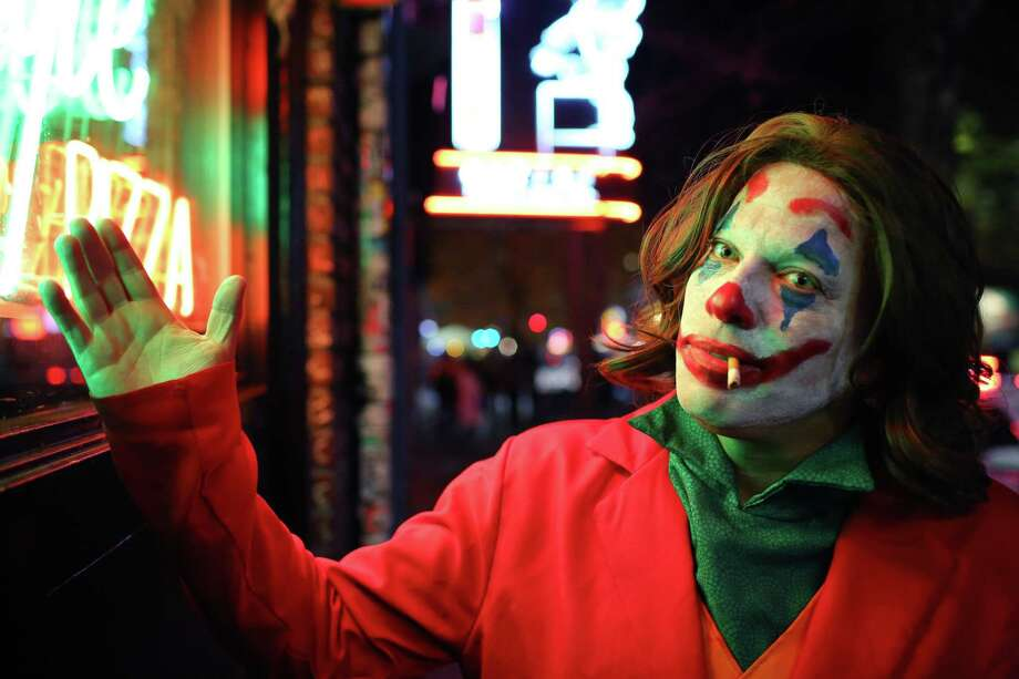 Yom Tov is dressed as The Joker for Halloween on Capitol Hill, Thursday, Oct. 31, 2019. Photo: Genna Martin, Seattlepi.com / GENNA MARTIN