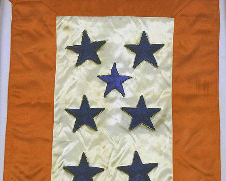 Service flags were a way to show how many family members were in the service during World War II. Photo: Photo Provided