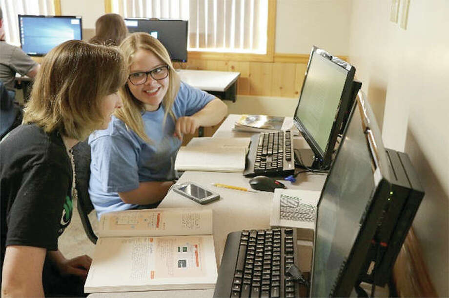 Students work together during an Excel class at John Wood Community College's Southeast Education Center. Photo: Photo Provided