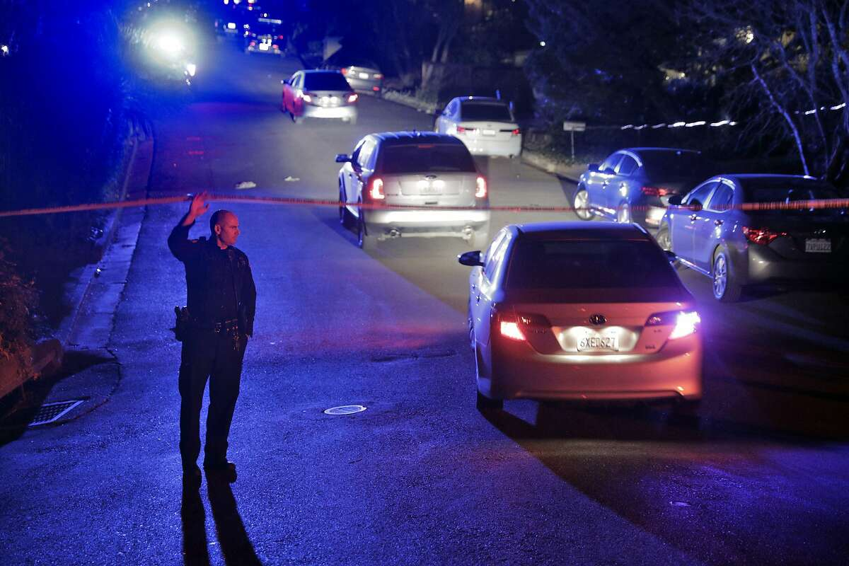 A Contra Costa Sheriffs at the intersection of Knickerbocker Lane and Spring Road near the location where several people were shot at a Halloween party on Lucille Way in Orinda.