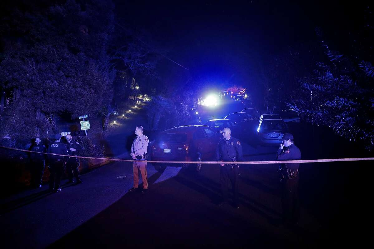 Contra Costa County Sheriffs deputies stand watch at a barricade at the intersection of Knickerbocker Lane and Spring Road near the location where several people were shot at a Halloween party on Lucille Way in Orinda , Calif., on Friday, November 1, 2019. Early reports stated that 4 people had been killed with others injured and transported to nearby hospitals. Though several of the injuries were believed to have been caused when guests ran from the shooting.