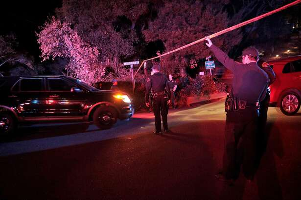 Contra Costa Sheriffs deputies hold the police tape up for investigators to drive under at the intersection of Knickerbocker Lane and Spring Road near the location where several people were shot at a Halloween party on Lucille Way in Orinda , Calif., on Friday, November 1, 2019. Early reports stated that 4 people had been killed with others injured and transported to nearby hospitals. Though several of the injuries were believed to have been caused when guests ran from the shooting.