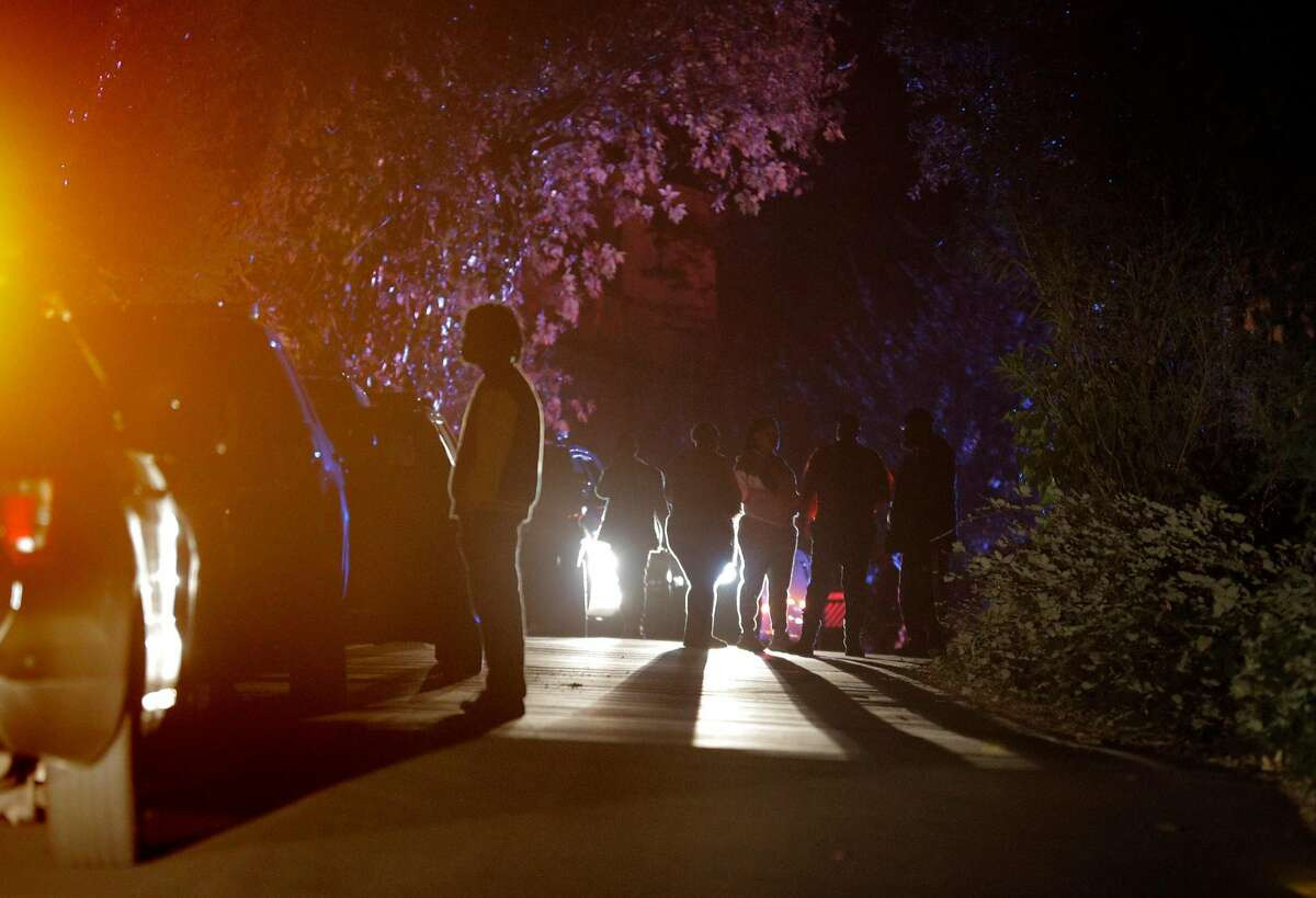 Several people gather at the intersection of Knickerbocker Lane and Spring Road near the location where several people were shot at a Halloween party on Lucille Way in Orinda , Calif., on Friday, November 1, 2019. Early reports stated that 4 people had been killed with others injured and transported to nearby hospitals. Though several of the injuries were believed to have been caused when guests ran from the shooting.