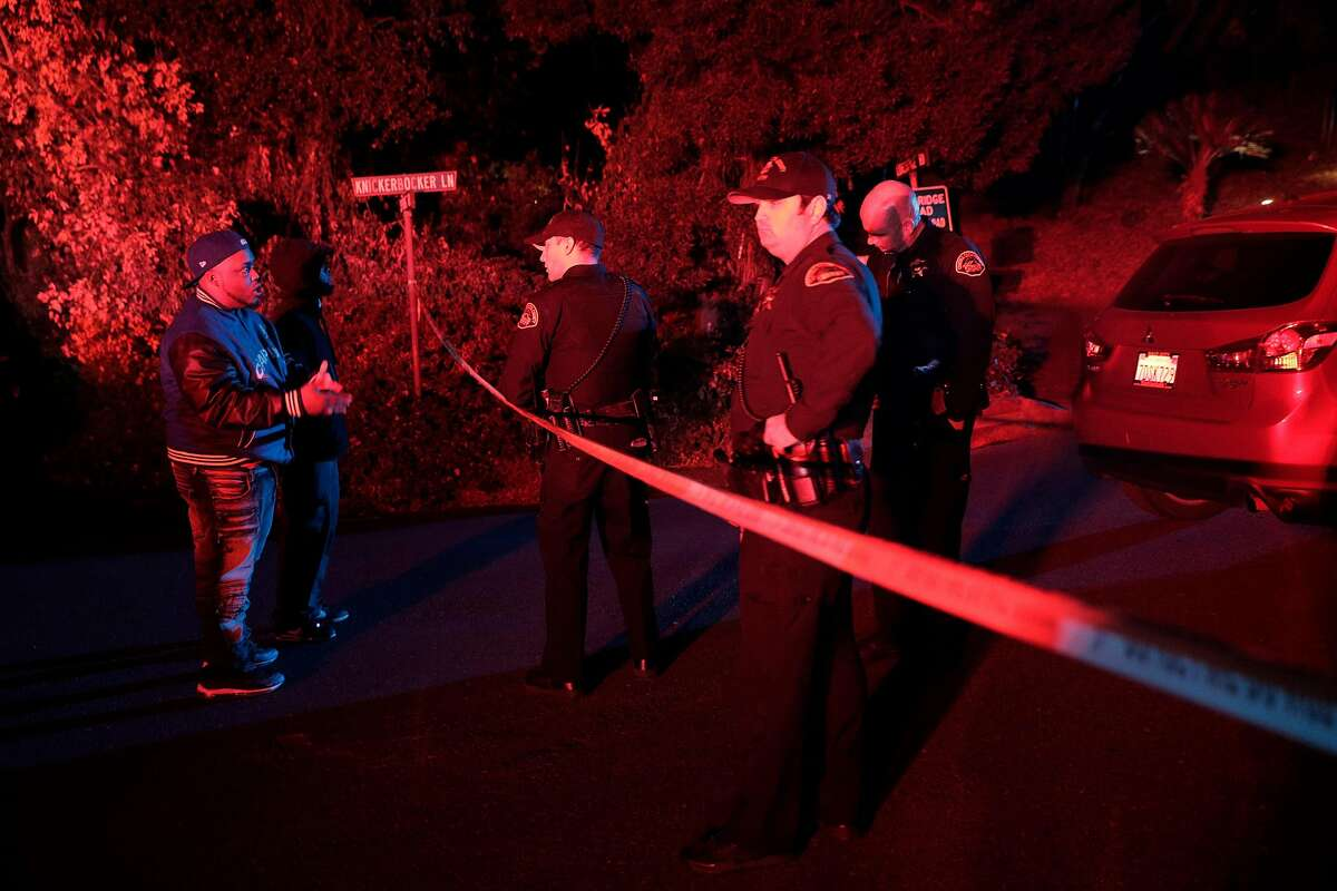 Two men whose cars had been caught up behind the police tape ask Contra Costa Sheriffs deputies if they can retrieve their cars at the intersection of Knickerbocker Lane and Spring Road near the location where several people were shot at a Halloween party on Lucille Way in Orinda , Calif., on Friday, November 1, 2019. Early reports stated that 4 people had been killed with others injured and transported to nearby hospitals. Though several of the injuries were believed to have been caused when guests ran from the shooting.