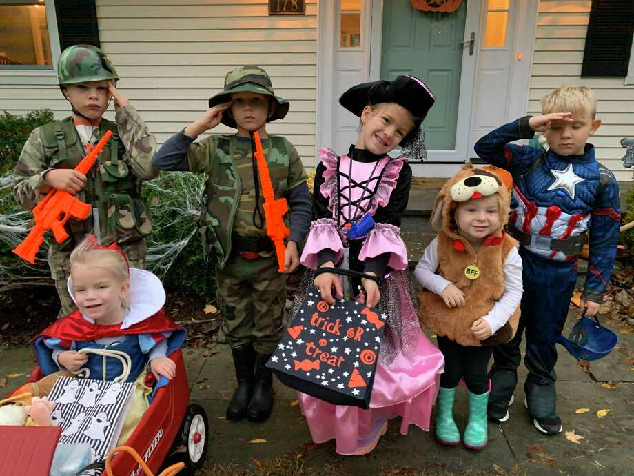 Two marines, Snow White, a pirate princess, a puppy and Captain America ready to trick-or-treat in the Westmoreland neighborhood. Photo: Nora Nosenzo / Contributed Photo