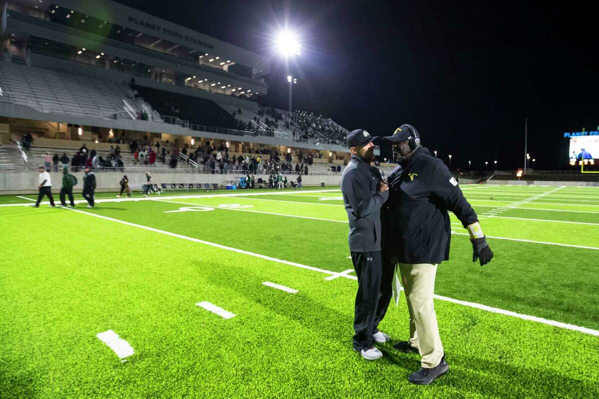 Spring head coach Trent Miller and Eisenhower head coach Eric Jackson shake hands after Spring defeated Eisenhower in a high school football game Thursday, Oct 31, 2019, in Spring, Texas.
