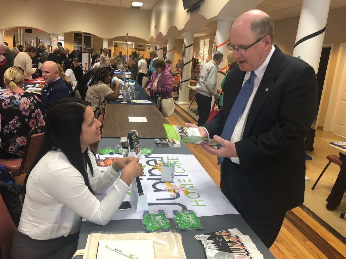 State Sen. Kevin Kelly talks with Sheila Perez of Juniper Home Care during the senior health and wellness fair Oct. 28 at the Shelton Senior Center.