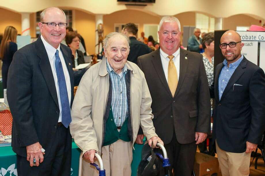 State Sen. Kevin Kelly, left, with, left to right, WWII veteran Roy Glover, and state Reps. Ben McGorty and Jason Perillo at the Shelton Senior Fair in October. The three lawmakers are holding a Facebook Live town hall Tuesday, April 14. Photo: Contributed Photo / / Connecticut Post