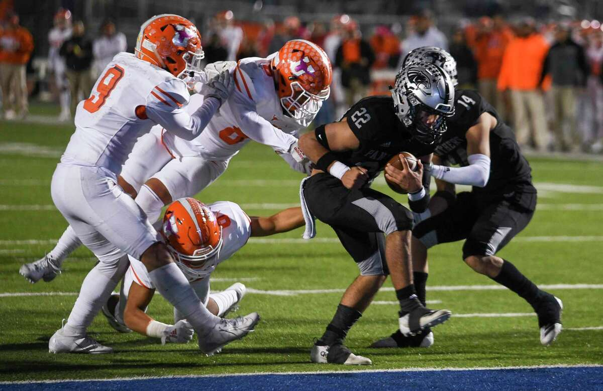 United South High School Brian Benavides runs into the end zone as the United High School defense attempts to take Benavides down, Thursday, Oct. 31, 2019,. at the UISD Student Activity Complex.