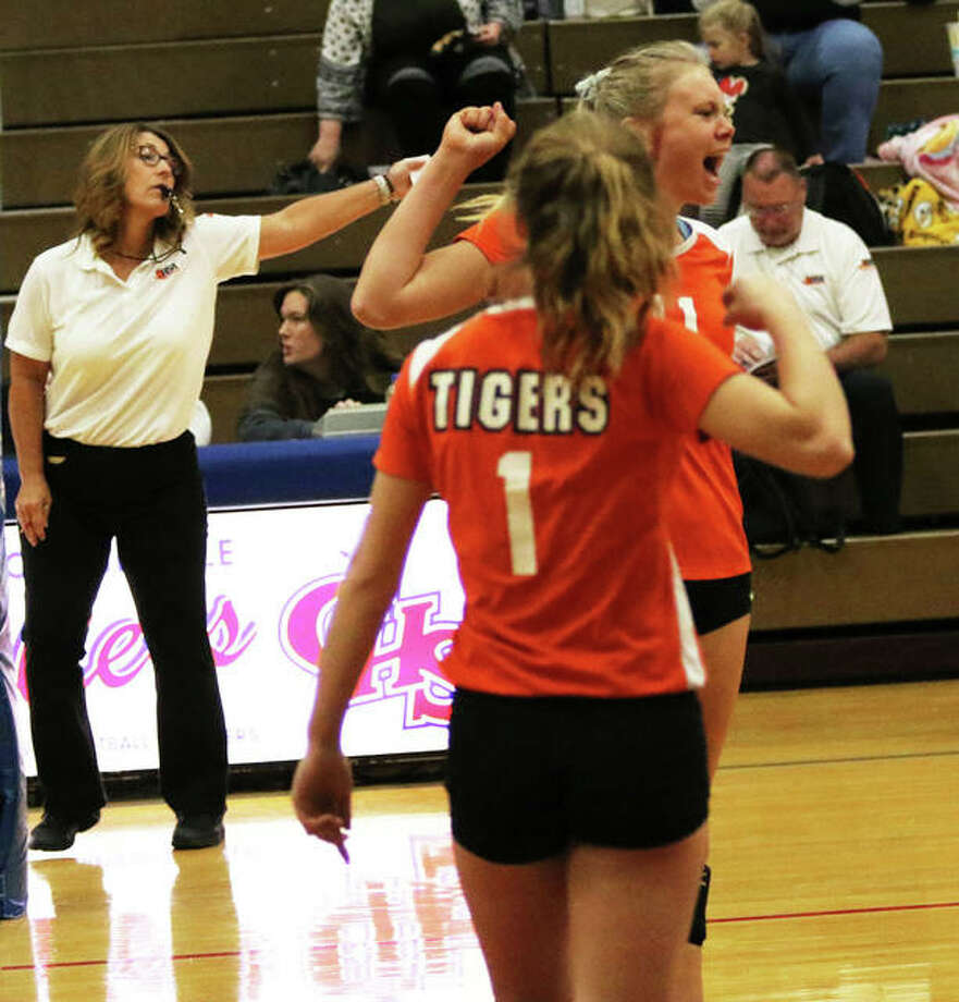 Greenfield's Kersty Gibbs celebrates a point with teammate Jessa Vetter (1) during an Oct. 5 match at the Carlinville Tourney. Gibbs had 10 kills to lead the Tigers to a win over Calhoun on Thursday at the Carrollton Class 1A Regional. Photo: Greg Shashack / The Telegraph