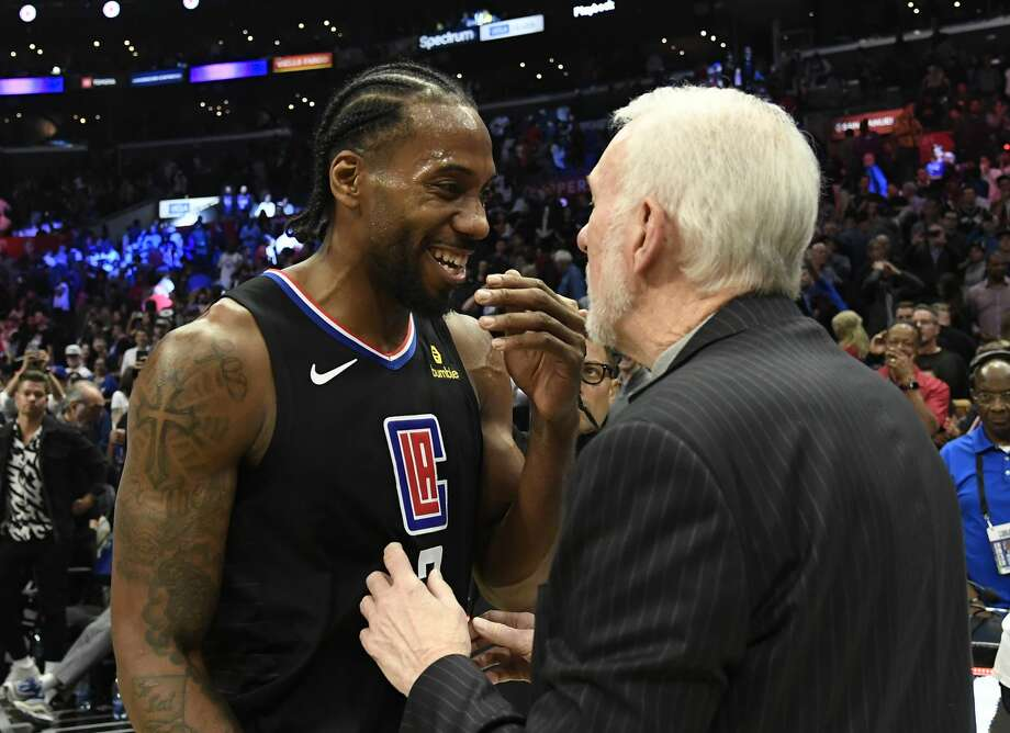 LOS ANGELES, CA - OCTOBER 31: Head coach Gregg Popovich of the San Antonio Spurs talks with Kawhi Leonard #2 of the Los Angeles Clippers after the basketball game at Staples Center on October 31, 2019 in Los Angeles, California. NOTE TO USER: User expressly acknowledges and agrees that, by downloading and/or using this Photograph, user is consenting to the terms and conditions of the Getty Images License Agreement. (Photo by Kevork Djansezian/Getty Images) Photo: Getty Images