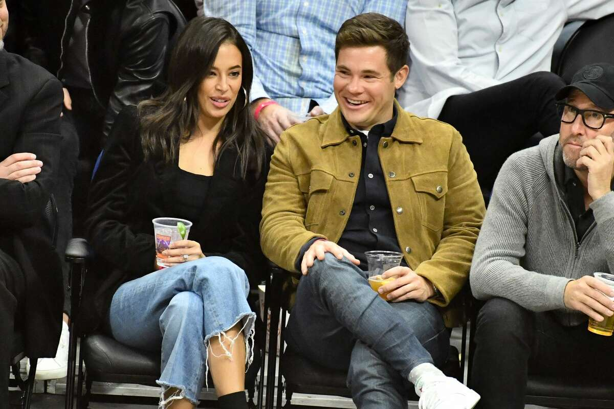 LOS ANGELES, CALIFORNIA - OCTOBER 31: Chloe Bridges and Adam DeVine attend a basketball game between the Los Angeles Clippers and the San Antonio Spurs at Staples Center on October 31, 2019 in Los Angeles, California. (Photo by Allen Berezovsky/Getty Images)