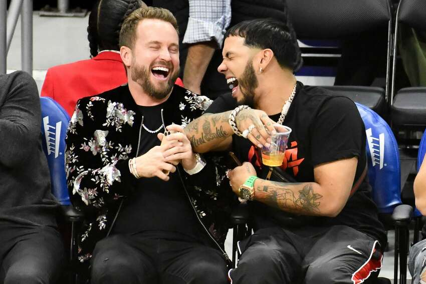 LOS ANGELES, CALIFORNIA - OCTOBER 31: RD Whittington (L) and Anuel AA attend a basketball game between the Los Angeles Clippers and the San Antonio Spurs at Staples Center on October 31, 2019 in Los Angeles, California. (Photo by Allen Berezovsky/Getty Images)
