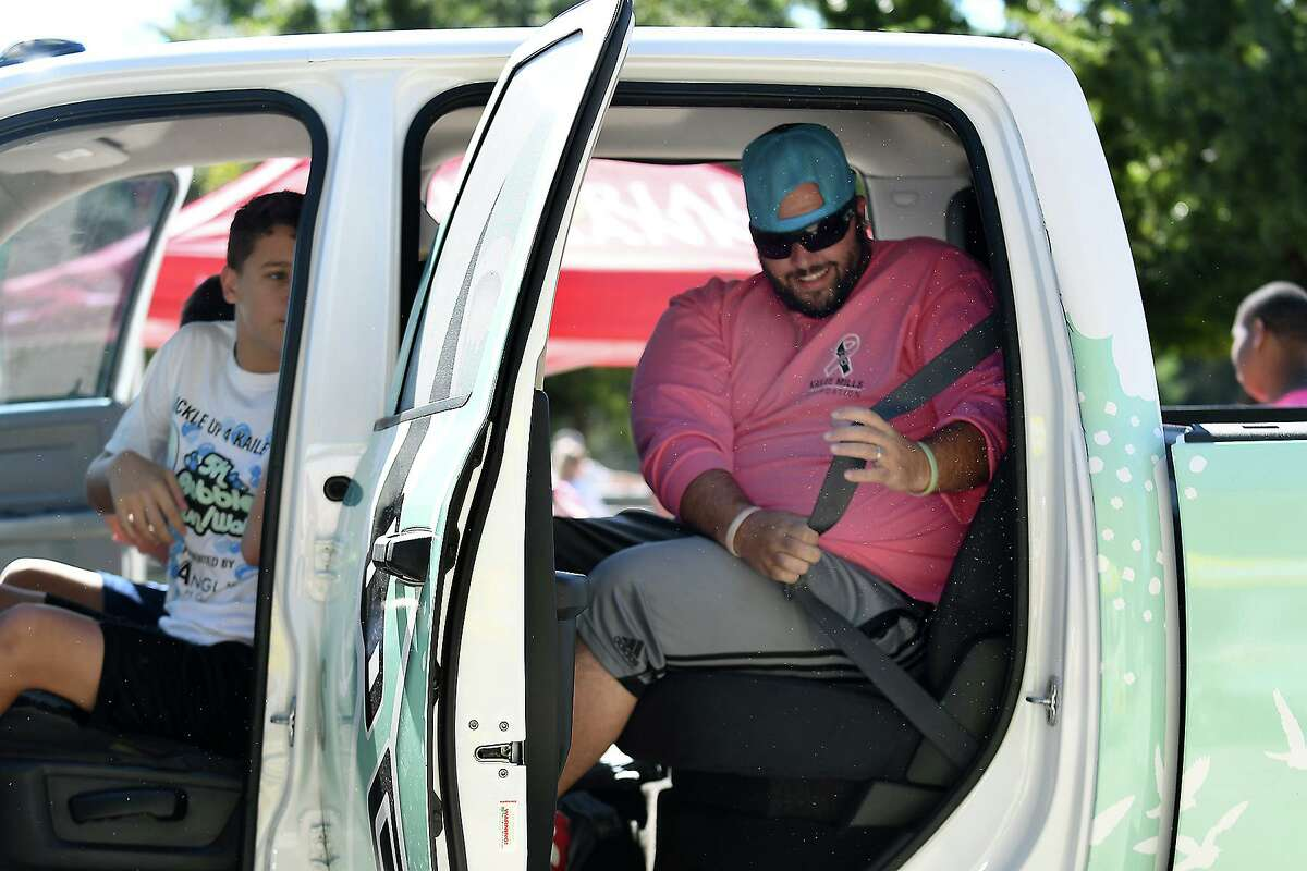 J.P. Fletcher, right, of Tomball, competes in the Seat Belt Challenge contest in the Kailee Mills Foundation truck with his sons Benn, Preston and Parker during the Buckle Up 4 Kailee 5K Bubble/Run Walk at Gullo Park in The Woodlands on Oct. 27, 2019. Kailee Mills, died at the age of 16 in a one-car accident in October 2017 due to not wearing her seat belt. The event benefits the Kailee Mills Foundation which was formed by her parents David and Wendy as a mission to inform the public on the importance of seat belt safety.