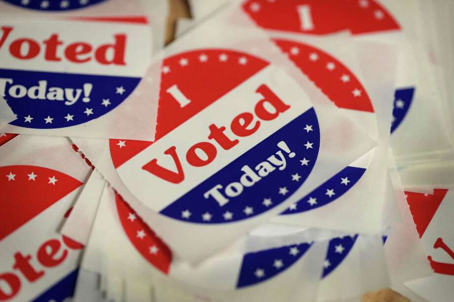 DES MOINES, IA - OCTOBER 08:  Stickers are made available to voters who cast a ballot in the midterm elections at the Polk County Election Office on October 8, 2018 in Des Moines, Iowa. Today was the first day of early voting in the state.  (Photo by Scott Olson/Getty Images) Photo: Scott Olson / Getty Images / 2018 Getty Images