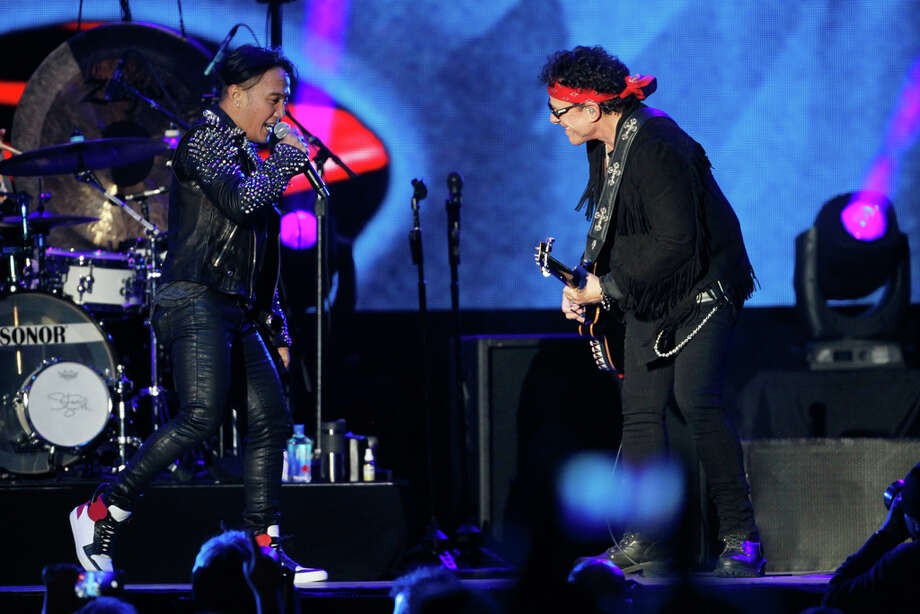 Journey lead singer Arnel Pineda and lead guitarist Neal Schon in 2016. Photo: Mathew Sumner, Special To The Chronicle / ONLINE_YES