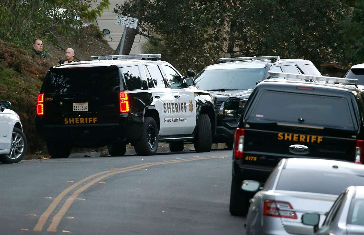 Sheriffs deputies stand by while investigators continue to collect evidence from a home on Lucille Way in Orinda, Calif. on Friday, Nov. 1, 2019 after four people were killed and several left injured in a shooting during a Halloween party Thursday night.