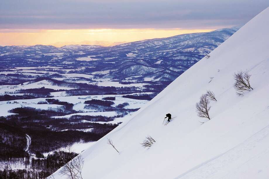 A skier descending a volcano near Shikotsu-Toya National Park. There are numerous ski resorts and opportunities for backcountry skiing around Niseko, on the island of Hokkaido in northern Japan. Photo: Photo For The Washington Post By Dina Mishev