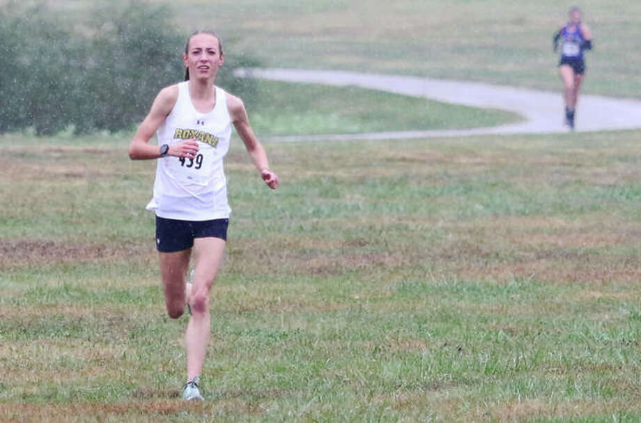 Roxana's Janelynn Wirth (left) heads home in first place at the New Athens Class 1A Regional cross country meet last Saturday. The next step on the path to the state meet for all three classes comes Saturday with local boys and girls qualifiers competing in Class 1A sectionals at Effingham and Benton, a Class 2A sectional in Decatur and Class 3A sectional in Normal.